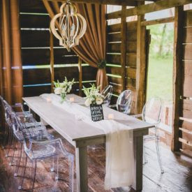 Intimate dining table set in barn.