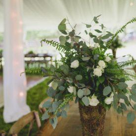 Floral arrangement in tent.