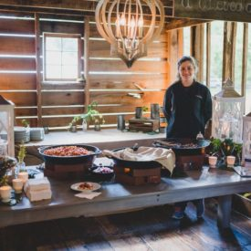 Chef-manned food station in barn.